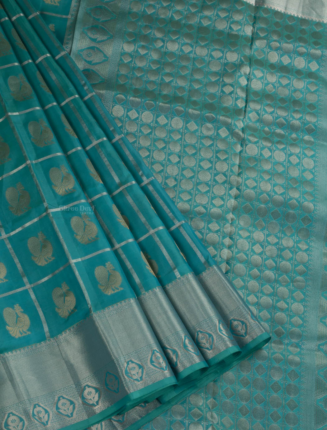 Pine Green Pure Soft Silk Saree with Golden Peacock Design